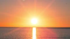 Sunset over Ocean - Beautiful Orange Sun Setting on Sea Water Waves Timelapse 4K Stock Footage