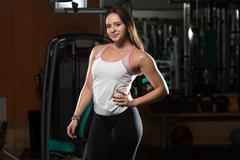 Young brunet woman posing in the gym Stock Photos