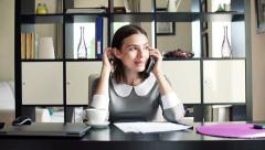 Young businesswoman talking on cellphone and drinking tea in office HD - stock footage