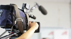 Videocamera and hands of cameraman. Stock Footage