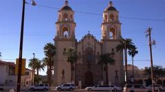 4K UHD Establishment shot old catholic double steeple church Stock Footage