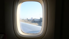 Asian Girl looking through the window the airport from the airplane-Dan Stock Footage