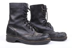 pair of black dirty army boots isolated on white background - stock photo