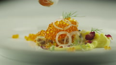 Eating Garnished Red Salmon Caviar with Spoon in Luxury Restaurant - stock footage