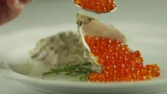Serving Red Salmon Caviar with Seashells in Luxury Restaurant - stock footage
