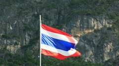 Thai flag waving in the wind and mountain as background Stock Footage