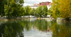 4k Potala reflection on lake in Lhasa park,Tibet.lake with tree in autumn. Stock Footage