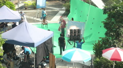Group of people make advertising and set up green screen studio outdoor Stock Footage