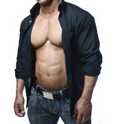 male bodybuilder in jeans and open shirt revealing pecs and abs - stock photo