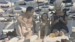 French Riviera 1956: family relaxing on the beach Stock Footage