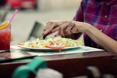Closeup of tasty salad being eaten with fork and knife NTSC Stock Footage