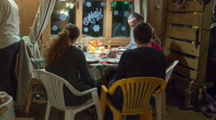 Timelapse of people celebrating Christmas at the table in rural house, Russia Stock Footage