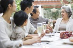 Family eating holiday meal together - stock photo