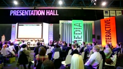 Pan view of people at presentation hall of the Russian Interactive Week Stock Footage