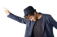 cute teenage boy in dancing pose with hat - stock photo