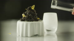 Black Caviar Garnished with Gold and Vodka in Luxury Restaurant - stock footage