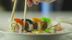Stock Video Footage of Eating Maki Sushi from Plate