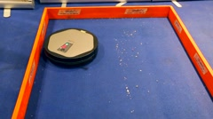 Vacuum cleaner robot, Robotics Expo Stock Footage