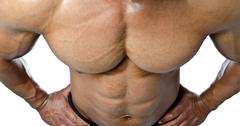 muscular torso and pecs of male bodybuilder shot from above - stock photo