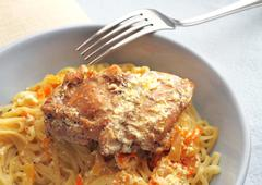 noodles with rabbit stewed with carrots and onions in sour cream - stock photo
