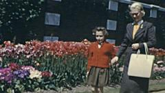 England 1956: mother and daughter walking in the park Stock Footage