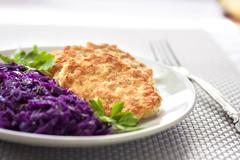 Chicken fritters and stewed red cabbage with caraway seeds Stock Photos