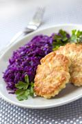 chicken fritters and stewed red cabbage with caraway seeds - stock photo