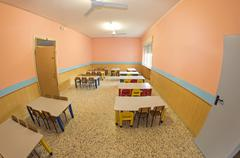 lunchroom of the refectory of the kindergarten with small benches - stock photo