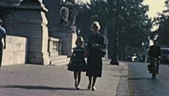 France 1956: mother and daughter walking in the street - stock footage