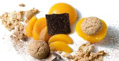 Stock Photo of ingredients for traditional italian dessert: peaches, amaretti, chocolate