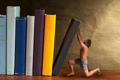 man supporting falling book in the bookshelf - stock illustration
