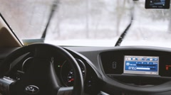 SUV car in snowy forest with turn on wipers. Stock Footage