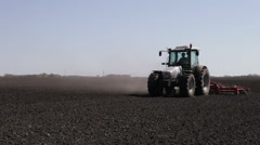 tractor plowing black field boundless - stock footage