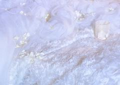 White fabric and glass on faux fur background Stock Photos