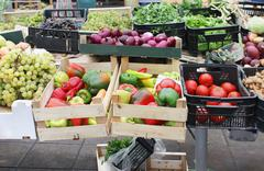 Fresh organic food piles sold on market Stock Photos