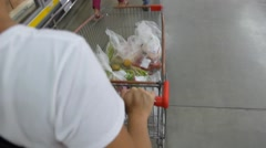 Closeup of Woman with Shopping Cart in Supermarket. - stock footage