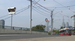 Streetcars Drive  Across a Bridge in Downtown Toronto Stock Footage