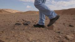 Legs walk Desert  side gimbal 4K Stock Footage