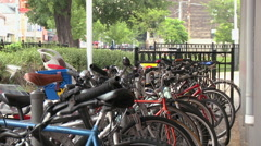 Streetcars pulls into station behind parked bikes Stock Footage