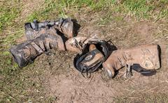 Dirty motorcycle boots after the competition in motocross Stock Photos