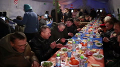 Beggars and homeless people receive a hot meal at Christmas. - stock footage