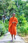 Buddhist monk walking to the camera Stock Photos