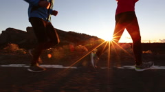 Running sport exercising runners training on road - Runner woman and man jogging - stock footage