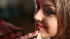 Model making-up for photography in studio. Stock Footage