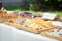 Table of meat and cheese Stock Photos