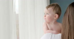 Baby 9m  looking out the window Stock Footage
