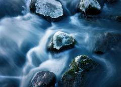 rock in streaming water - stock photo
