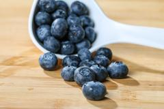 Blueberry  on a spoon concept for healthy eating and nutrition Stock Photos