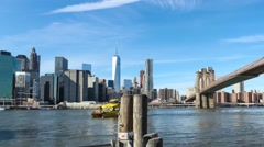 Brooklyn Bridge Manhattan and NYC Water Taxi Time Lapse.mp4 Stock Footage