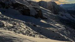 Shadows moving across snow slopes below Cima Brenta Stock Footage
